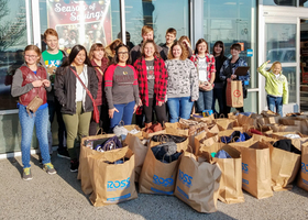 Woodland High School students give back by buying food, clothes, and gifts for families in need