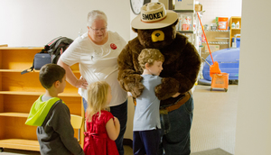 Smokey the Bear teaches Woodland Primary School students how to prevent forest fires