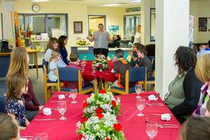 Students learn proper table etiquette and try new foods during the Fine Dining Event at Woodland Intermediate School