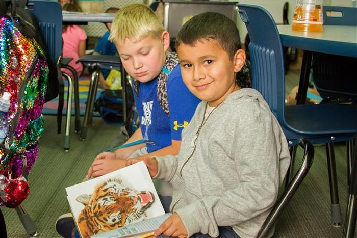 Book Buddies at Woodland Intermediate School work together to improve their reading skills.