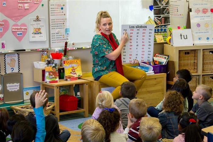 Jill Thoeny, one of Woodland Primary's two bilingual kindergarten teachers, teaches half of each school day in Spanish and the other half in English