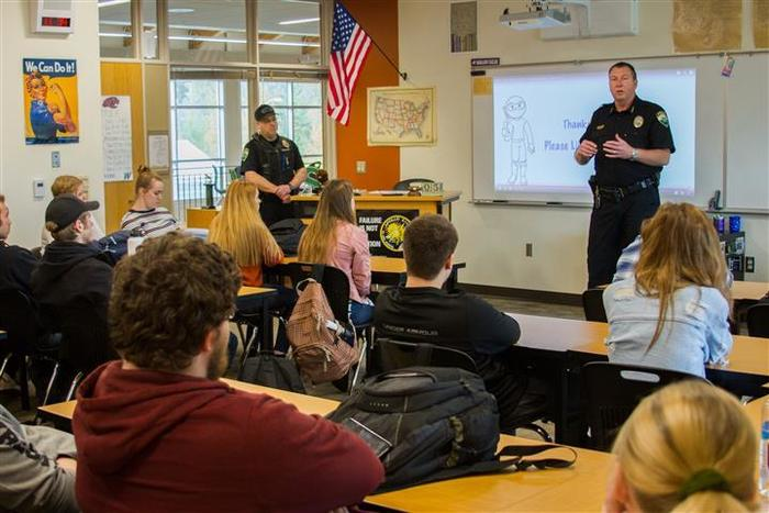 Woodland Police Chief Jim Kelly and Officer Brent Murray visited Katie Klaus' WHS government class