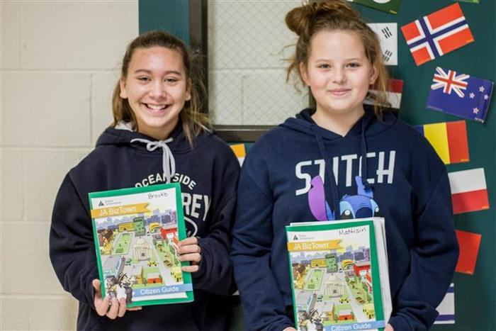 Sixth graders Brooke Beassie and Mattison Moss were very excited to attend JA BizTown to use their class lessons in a simulated town economy.