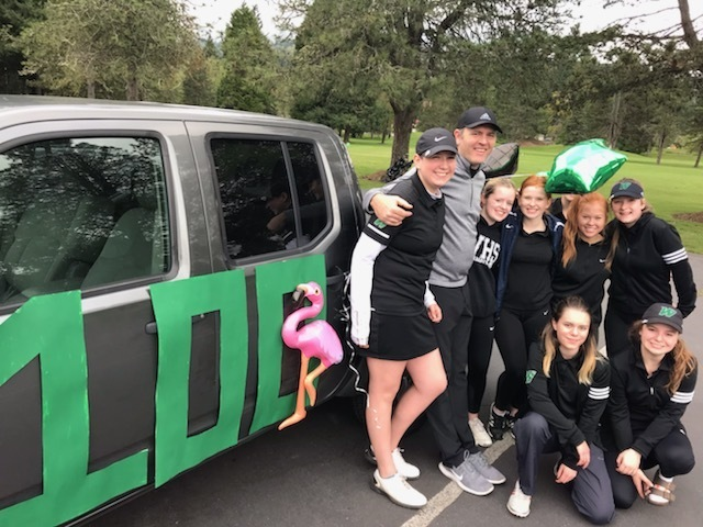 Coach Aaron Blackwelder and the WHS Girls Golf Team celebrate his 100th Career Win
