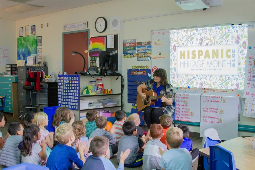 Maria Rodriguez, also an accomplished musician and singer, uses music and song to teach her first grade Dual Language students.
