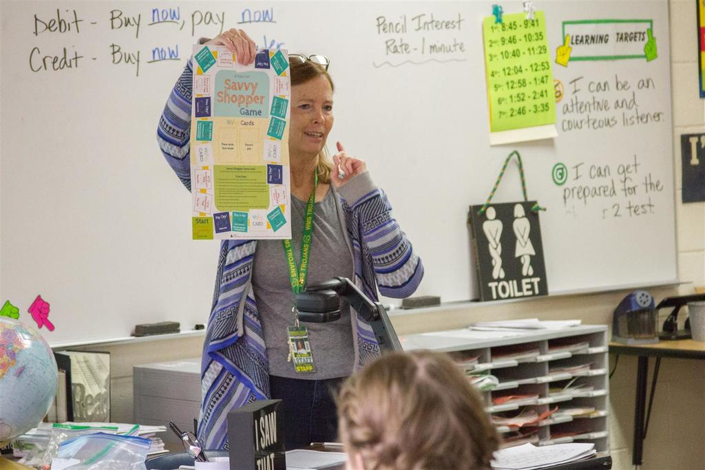 Robin Uhlenkott teaches financial literacy during Woodland Middle School's Personal Finance and Citizenship class started in 2018.