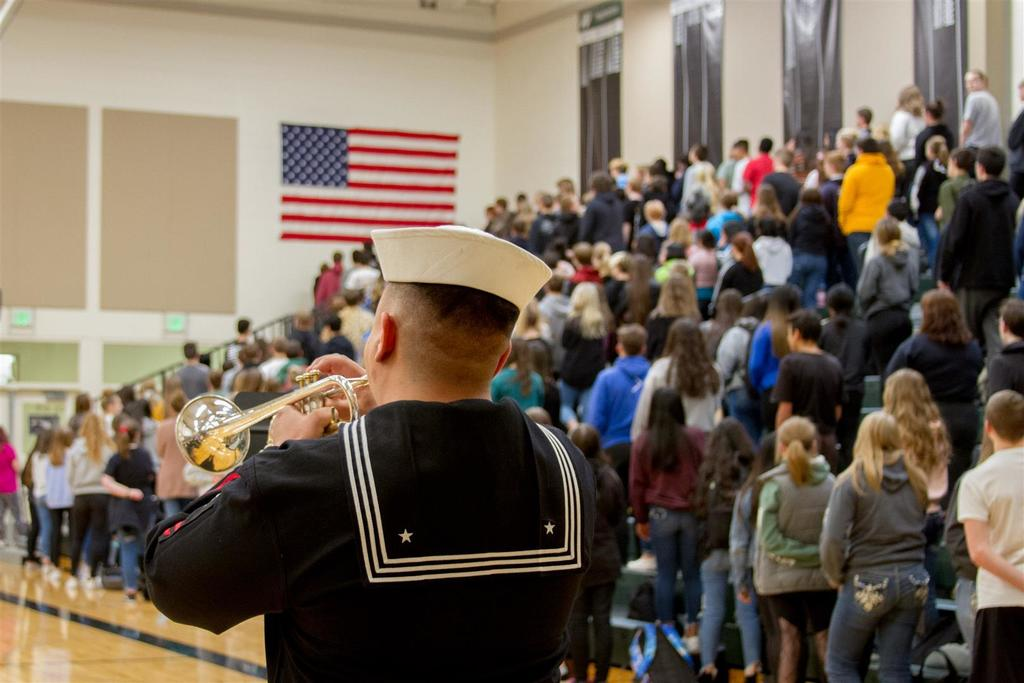 Petty Officer 1st Class Andres Velandia played the National Anthem in true military fashion on a trumpet