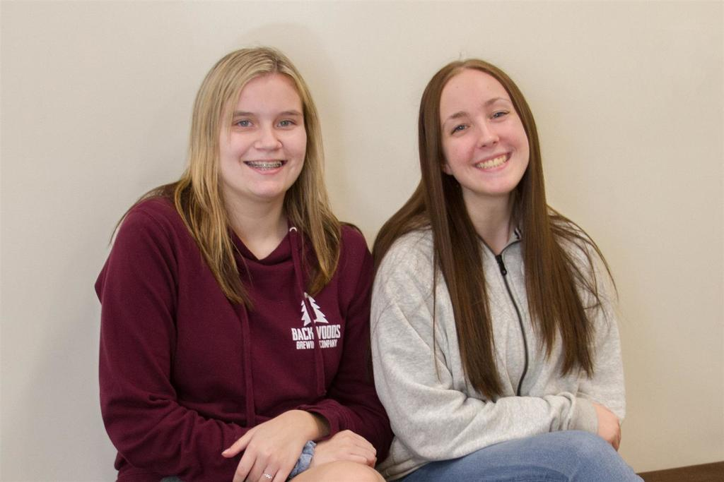 "Ileen Kafferlin (junior, left) and Madison ""Madi"" Gosser (sophomore, right) credit the PASS team with helping them turn around failing grades and become successful in high school."