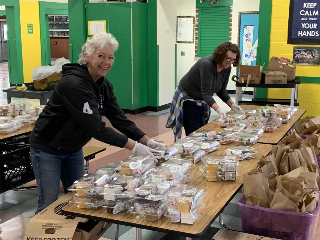 Woodland Public Schools staff packed meals while maintaining social distancing