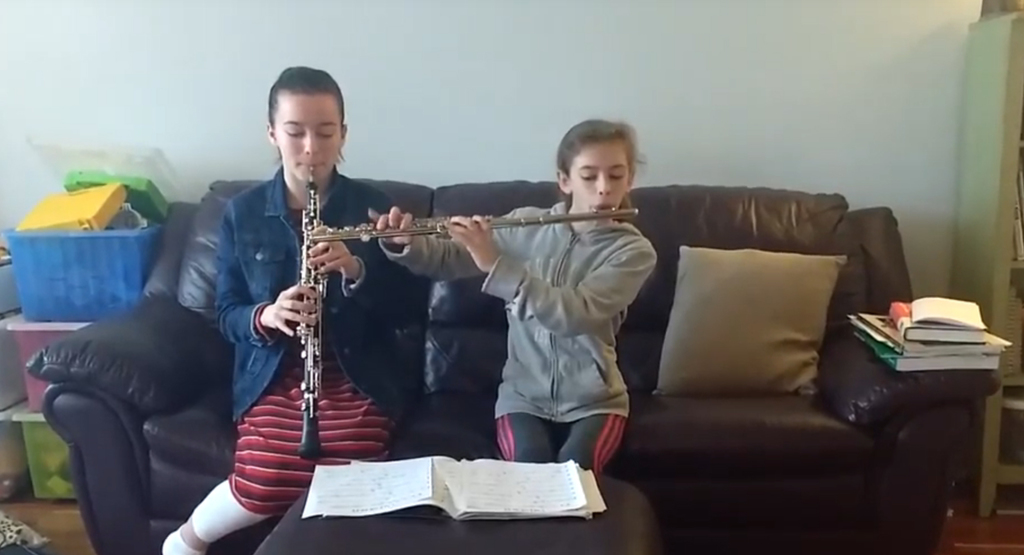 Grace and Abigail Heffernan continue learning by practicing their musical instruments