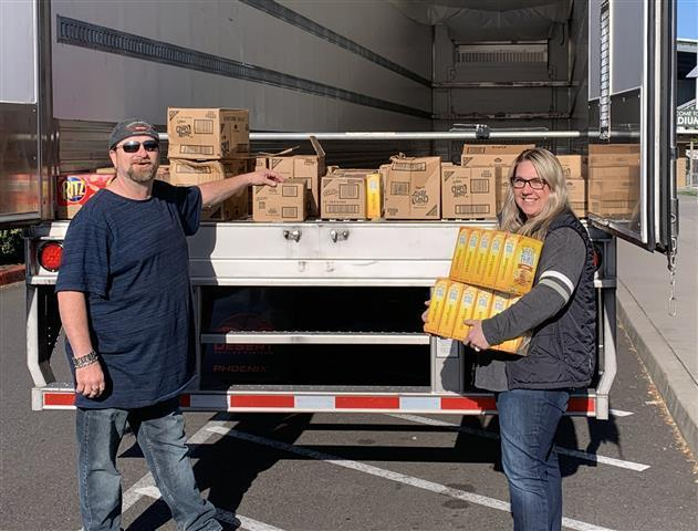 Shawn Fenmore, a driver with Landstar Ranger Trucking, drove 25 cases of unwanted cookies and crackers up to Woodland after his last stop in Vancouver to say thanks for Woodland Public Schools opening the high school as a temporary rest area for drivers during the closure