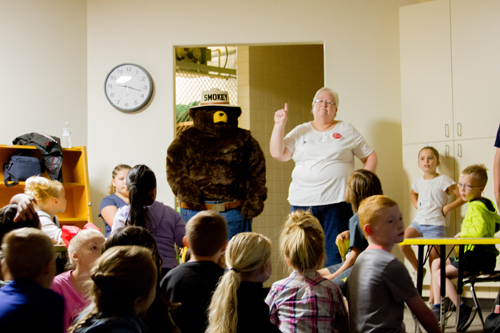 Smokey the Bear quizzed students on their lessons with the help of local volunteer, Vicky Black