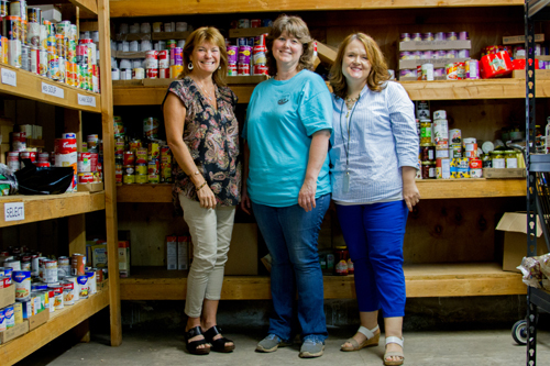 The Woodland Action Center partners with Woodland Public Schools to help provide families-in-need more access to food and resources. (Pictured, left to right: Heidi Butler, volunteer; Julie Clark, Woodland Action Center Warehouse Coordinator; and Leslie Mohlman, Community, Family, Student Resource Coordinator for Woodland Public Schools)