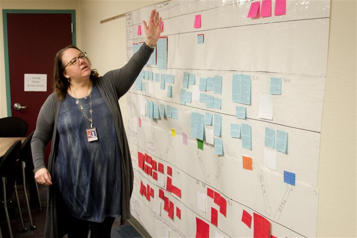 Woodland Primary School Principal Ingrid Colvard shows the planning timeline for how each element of the dual language program's lessons intersect, ensuring enrolled students learn the same lessons as their single-language counterparts throughout the year
