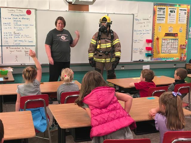 Firefighters dressed in full gear so students could get familiar with them