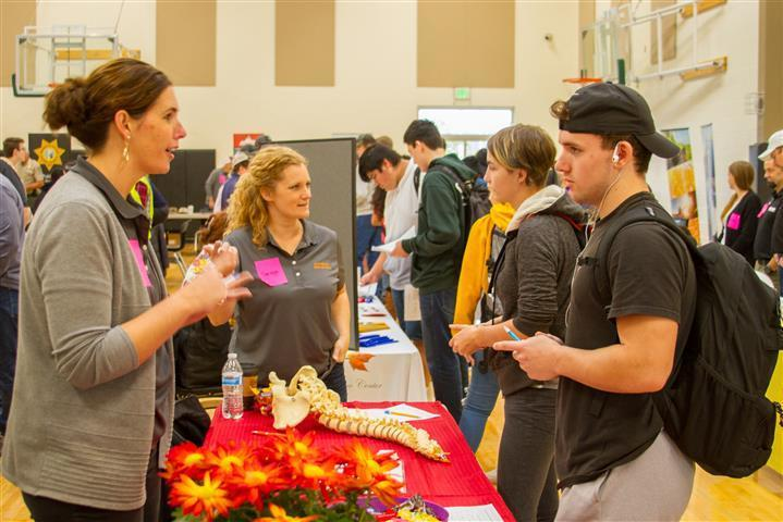 More than 40 local businesses attended Woodland Days to speak with students like Spenser Best (pictured here, right)