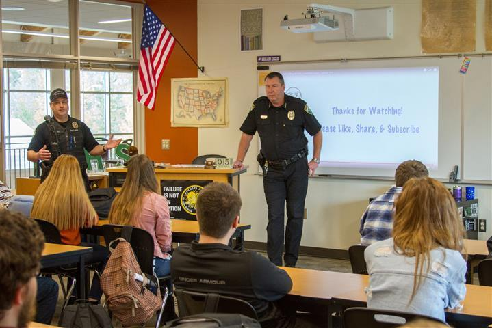 Officer Brent Murray distributed handouts with examples of how modern technology has created hard-to-find weapons, presenting challenges to law enforcement.