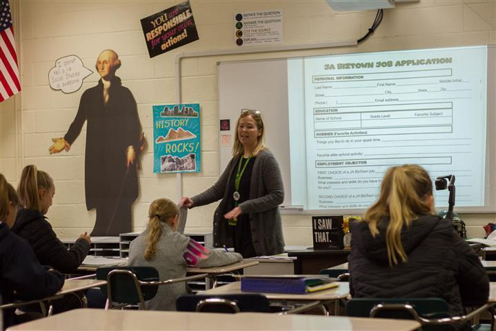 Robin Uhlenkott teaches financial literacy as part of Woodland Middle School's new Personal Finance and Citizenship class introduced this school year.