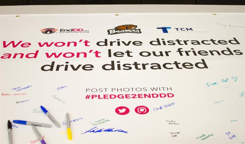 Students had the opportunity to sign a banner pledging not to drive distracted or let others drive distracted.