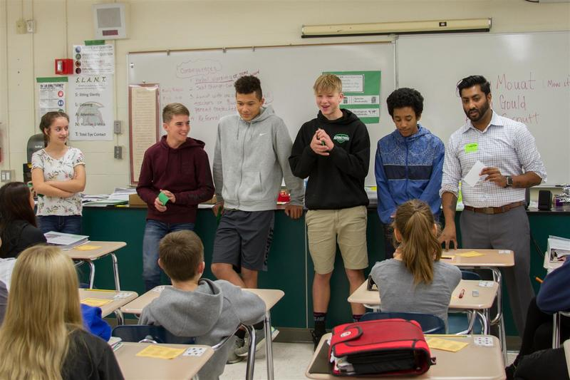 Zaheen Khan (far right), a Fibre Federal Credit Union community outreach specialist, guided students through a scenario where a high school dropout tries to make ends meet on $2,500 a month.